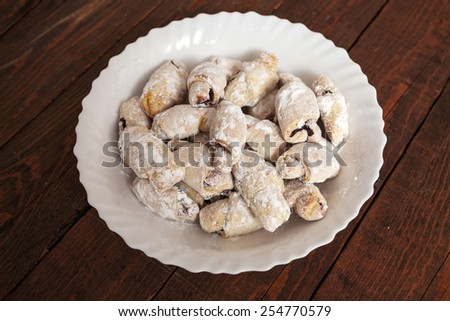 Homemade fresh biscuit with strawberry jam and poured with sugar - stock photo