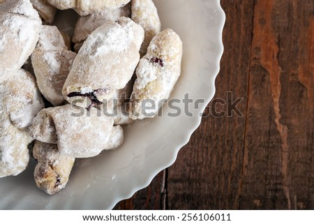 Homemade fresh biscuit with strawberry jam poured with sugar - stock photo