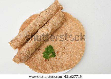 Homemade fresh chapati, chapathi, chapatti, roti or flatbread made from whole wheat flour / atta Mumbai North India. famous Indian basic food.