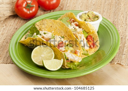Homemade fresh fish tacos on a green plate - stock photo