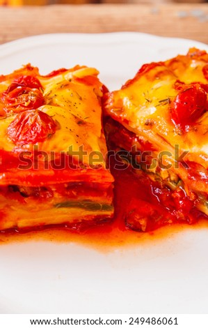 Homemade Fresh Lasagna topped with Melted Cheese and Tomato, Oven Baked, Italian Cuisine, Serve on Dish with tomato gravy sauce / Home Cooking Food Delicious. - stock photo