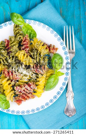 Homemade fresh pest with pasta with grated parmesan served on plate - stock photo
