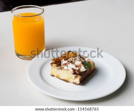 Homemade fresh sweet waffles cake on plate with orange juice. - stock photo
