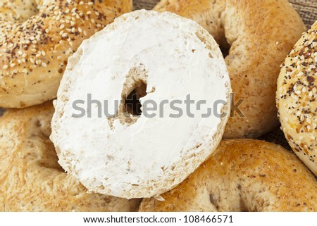 Homemade Fresh Whole Grain Bagel with cream cheese - stock photo