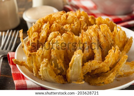 Homemade Fried Bloomin Onion with Dipping Sauce - stock photo