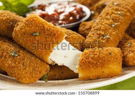 Homemade Fried Mozzarella Sticks with Marinara Sauce - stock photo