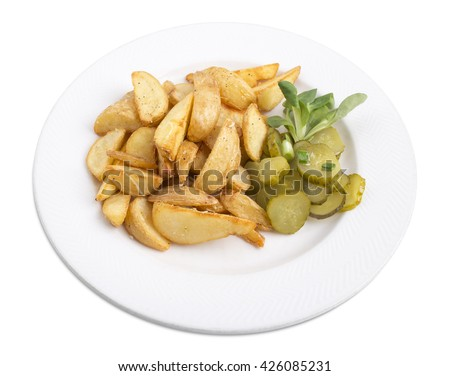 Homemade fried potatoes with pickles.  Isolated on a white background. - stock photo