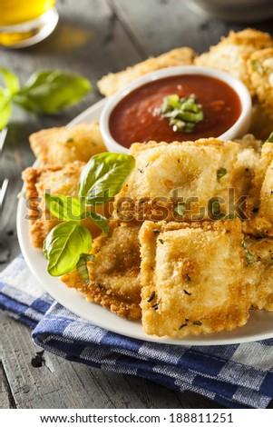 Homemade Fried Ravioli with Marinara Sauce and Basil - stock photo