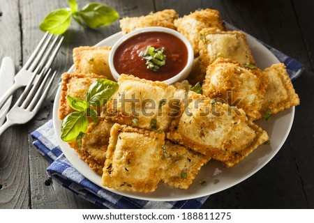 Homemade Fried Ravioli with Marinara Sauce and Basil - stock photo