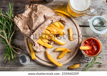 Homemade fries served with beer - stock photo