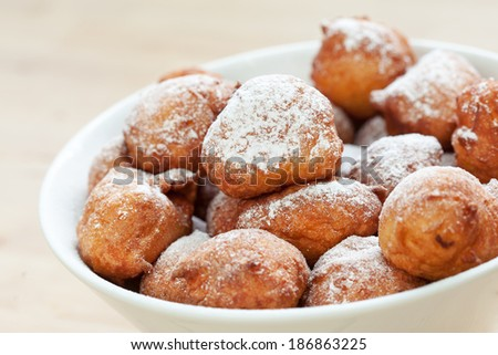 Homemade fritters in white bowl Traditional croatian cookies called Fritule - stock photo