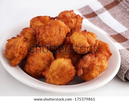 Homemade fritters on plate. Traditional croatian cookies called Fritule. - stock photo