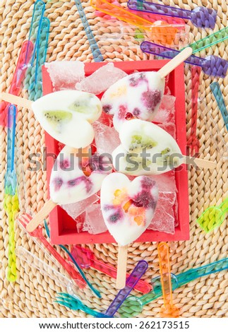 Homemade frozen popsicles with yogurt and fresh fruits - stock photo