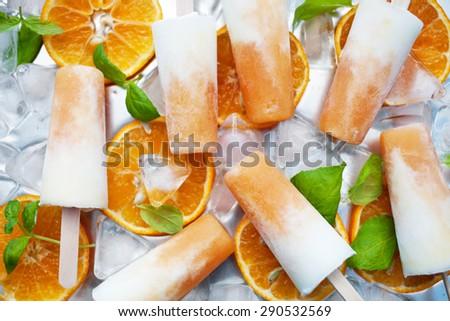Homemade frozen yogurt cantaloupe popsicles - stock photo