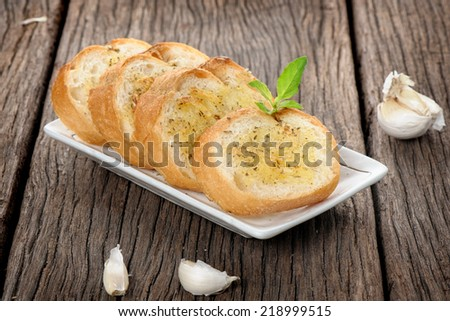 homemade garlic bread with herbs in the kitchen - stock photo