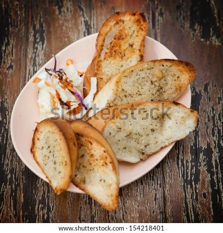 Homemade garlic & herb bread. - stock photo