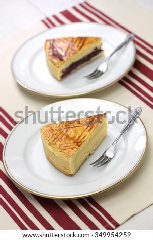 homemade gateau basque, dark cherry jam and custard cream - stock photo