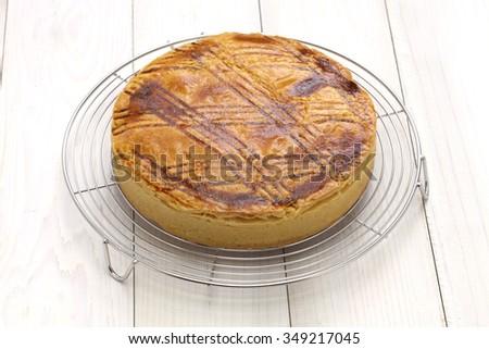 homemade gateau basque on cake cooler, freshly baked - stock photo