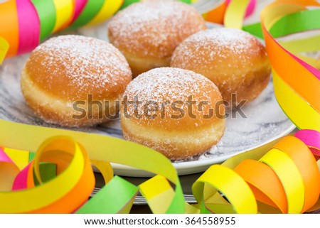 Homemade german donuts - krapfen or berliner - filled with jam. Selective focus and natural light.  - stock photo