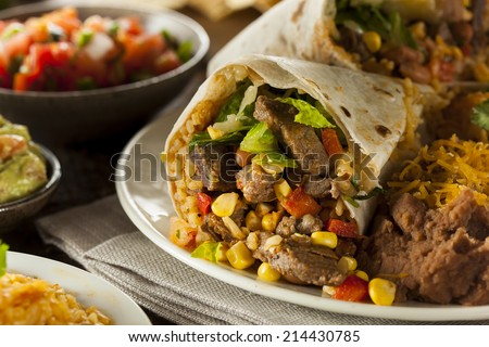 Homemade Giant Beef Burrito with Lettuce Salsa and Rice - stock photo