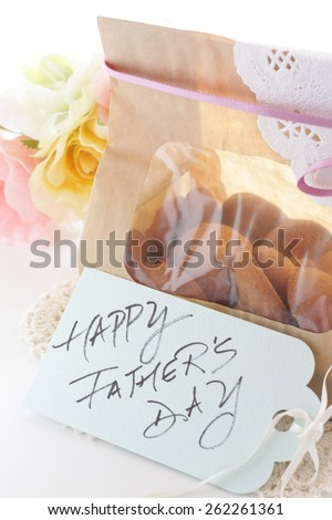 Homemade ginger cookie in paper bag for gift image - stock photo