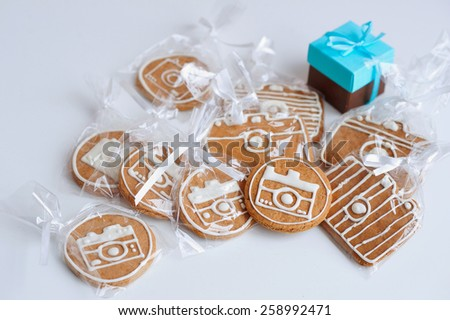 Homemade gingerbread biscuits and present box  - stock photo