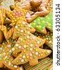 Homemade gingerbread christmas tree cookies. Shallow dof. - stock photo