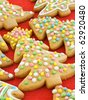 Homemade gingerbread christmas tree cookies with colored glaze. Shallow dof. - stock photo