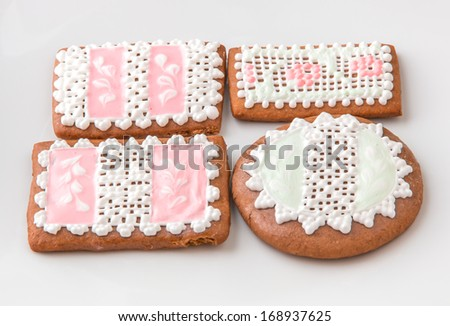 Homemade gingerbread cookies decorated in pastel colors. - stock photo