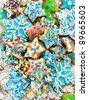 Homemade gingerbread cookies with colored icing. Viewed from above. - stock photo