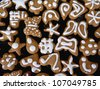 Homemade gingerbread cookies with white glaze. - stock photo