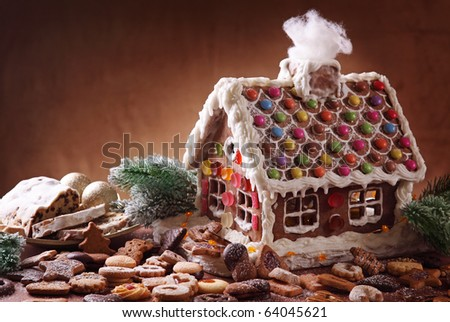 Homemade gingerbread house and christmas cakes - stock photo