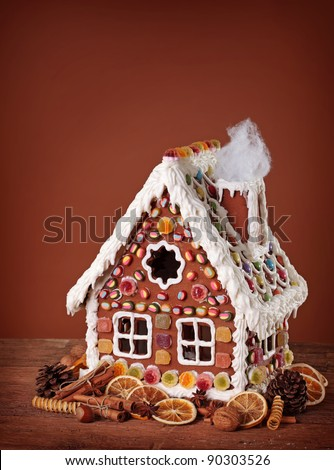 Homemade gingerbread house and christmas spices