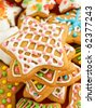 Homemade gingerbread star cookies with colored glaze. Shallow dof. - stock photo