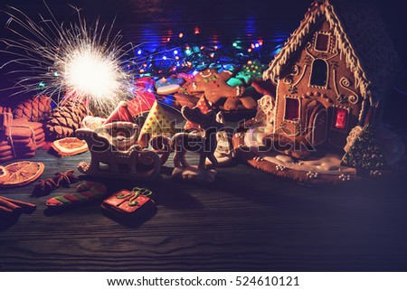 Homemade gingerbreads for new year holiday on dark wooden background, xmas theme