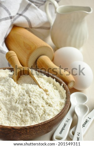 Homemade gluten free flour blend from rice flour, millet flour, potato starch and xanthan gum in wooden bowl met scoop - stock photo