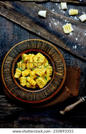 Homemade gnocchi with sweet potatoes and garlic - stock photo