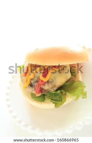 homemade gourmet Cheese burger on dish with copy space