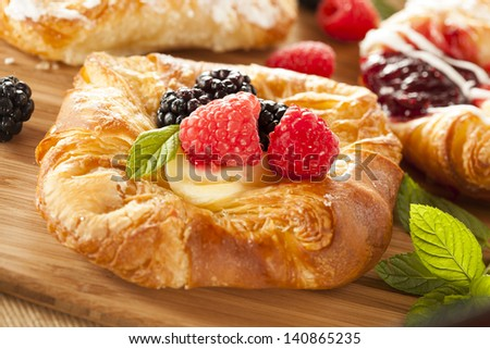 Homemade Gourmet Danish Pastry with berries and icing - stock photo