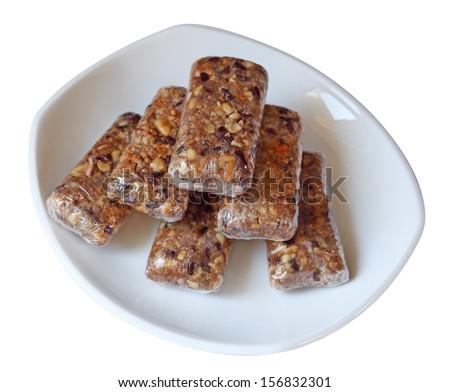 Homemade granola bars isolated on white - stock photo