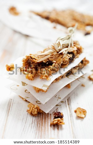 Homemade granola bars with fresh muesli and raisins - stock photo