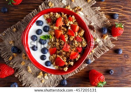 Homemade granola Breakfast with yogurt and fresh fruit berries. concepts health food - stock photo