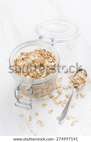 homemade granola in a glass jar, top view - stock photo