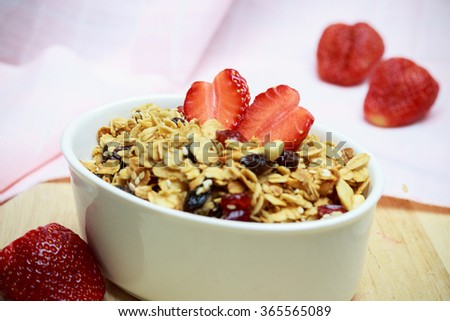 Homemade granola with nuts and dried cranberries strawberry shape of heart, Breakfast health food