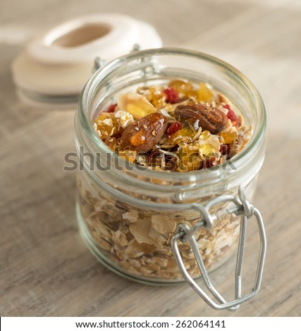 Homemade granola with oats, toasted nuts, dried cherry, selective focus - stock photo
