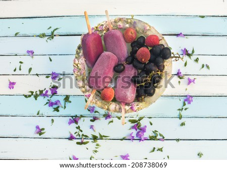 homemade grapes and lichi Popsicles in an ice bowl - stock photo