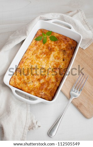 Homemade gratin casserole with eggs and cheese - stock photo