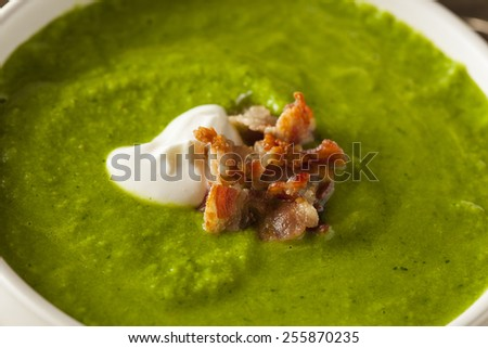 Homemade Green Spring Pea Soup with Cream and Bacon - stock photo