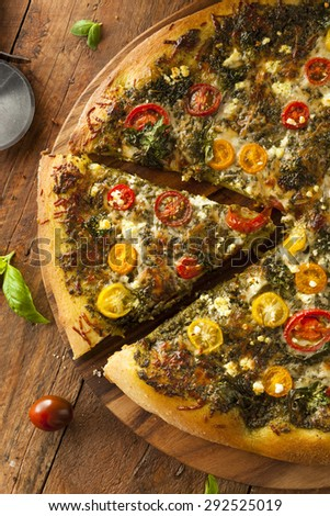 Homemade Grilled Pesto Pizza with Kale and Heirloom Tomatoes - stock photo