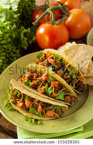Homemade Ground Beef Tacos with Lettuce, Tomato, and Cheese - stock photo